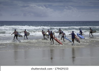"""AUSTRALIA - JANUARY 11 - A group of young surf lifesavers (known as """"Nippers"""") complete in a board race as they train to be surf lifesavers on the Gold Coast in Queensland on January 11, 2014."""