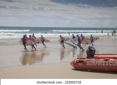 """AUSTRALIA - JANUARY 11 - A group of young surf lifesavers (known as """"Nippers"""" ) complete in a board race as they train to be surf lifesavers on the Gold Coast in Queensland on January 11, 2014."""
