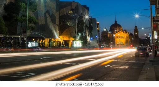 AUSTRALIA, MELBOURNE - OCTOBER 23, 2014: Long exposure night shot Melbourne's ACMI Museum, Australia's only national museum of film, videogames, digital culture, with Flinders Street Station behind