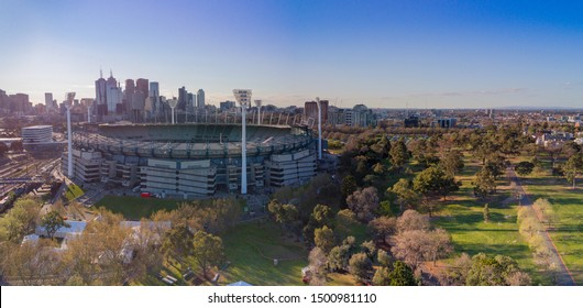AUSTRALIA, MELBOURNE - SEPTEMBER 21, 2018: Aerial shot of the Melbourne Cricket Ground with Melbourne city skyline behind
