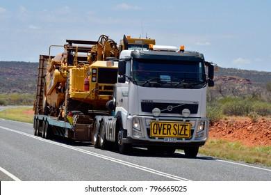 Australia, Northern Territory - November 15, 2017: Heavy oversize transport with truck named Road Train on Stuart Highway
