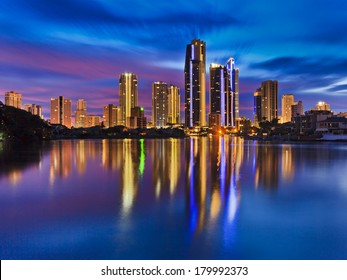 Australia QUeensland SUrfers paradise CBD city reflection in still waters of river at sunrise blue-pink cloudy sky