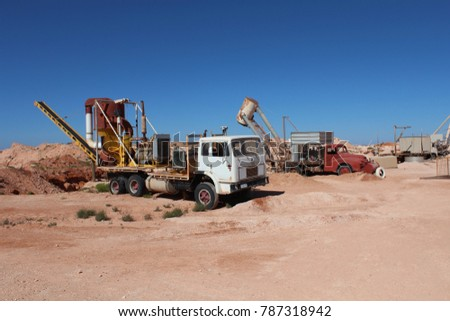 AUSTRALIA, SOUTH AUSTRALIA, COOBER PEDY, AUGUST 11, 2016: Classic mining trucks at a mining in Coober Pedy, Australia.
