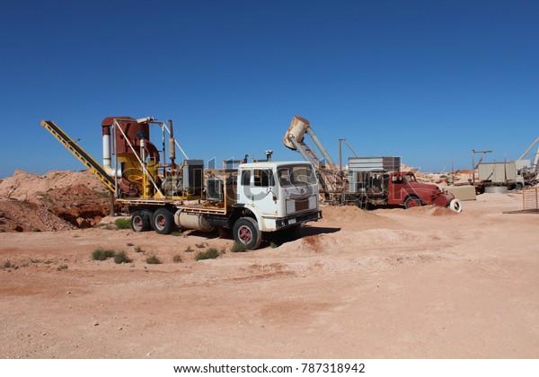 AUSTRALIA, SOUTH AUSTRALIA, COOBER PEDY, AUGUST 11, 2016: Classic mining trucks at a mining in Coober Pedy, Australia.