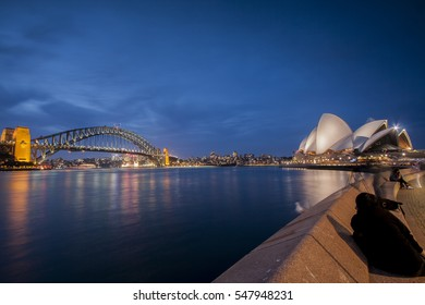 Australia, SYDNEY - 31 August 2013: Tourists walk along the foreshore of Sydney's Darling Harbour.
