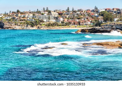 in  australia  sydney the bay the rock and the ocean near bondi beach