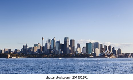 Australia sydney city CBD view from Cremorne point over blue harbour waters under clear sky