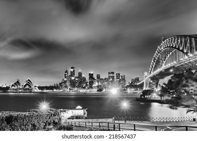 Australia Sydney city landmarks high-rise skyscrapers and sydney harbour bridge after sunset illuminated black-white