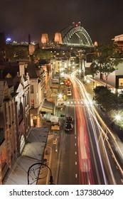 australia sydney city the rocks historic district view from above illuminated street night scene harbour bridge and old houses tourist landmark