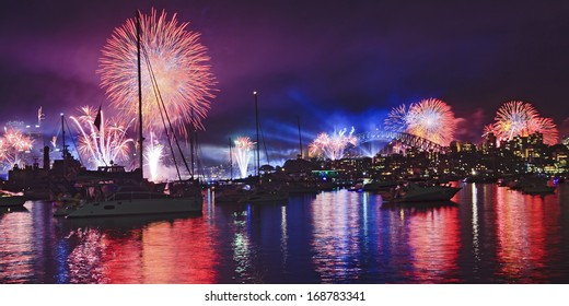 Australia Sydney Harbour water fireworks New Year eve over anchored boats fire balls and light show lasers in the sky