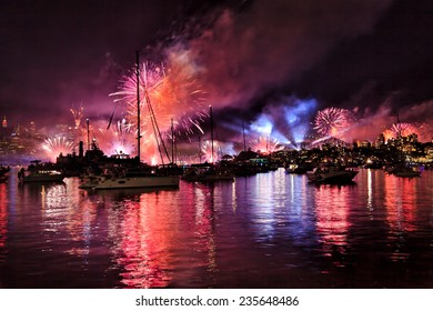 Australia Sydney Harbour waters with boats, yachts and people watching spectacular NAVY fireworks and New Year Eve over Sydney city CBD and harbour bridge