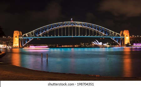 australia sydney NSW city landmarks harbour bridge and harbour waters at vivid light show illuminated with lights reflecting after sunset