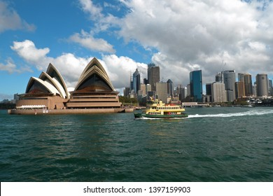 Australia, Sydney: September 16 2015: Cityscape - Sydney Opera House and skyscrapers of city centre and ferry in front of view