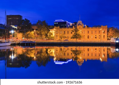 Australia Tasmania Hobart gallery of state historic architecture building illuminated after sunset reflecting in still waters of Hobart harbour Sullivan's cove