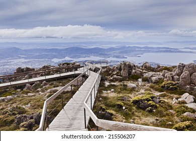 Australia Tasmania Hobart view from Mt Wellington top lookout over Tasman bridge and city suburbs with distant land and clouds