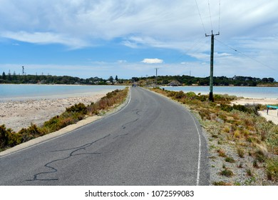 Australia,  two cyclists on Bigby road between two lakes on Rottnest Island