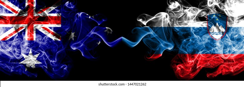 Australia vs Slovenia, Slovenian smoky mystic flags placed side by side. Thick colored silky smokes combination of national flags of Australia and Slovenia, Slovenian