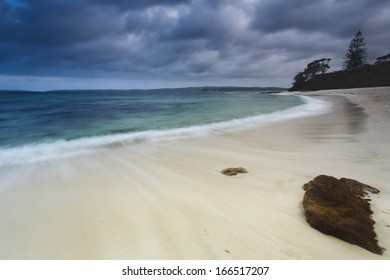 australia white sand beach cloudy weather long exposure blurred bay water