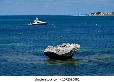 Australia, yacht and mushroom rock in Indian ocean on Rottnest island