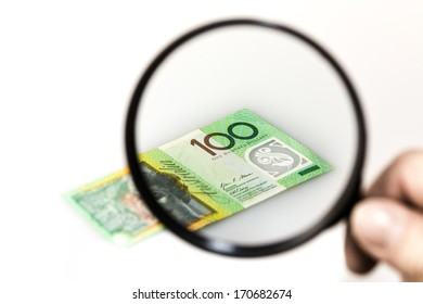 Australian 100 note under a magnifying glass