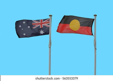 australian and australian aboriginal flag against blue sky background