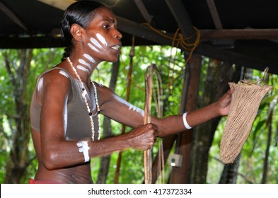Australian Aboriginal woman explain about the home tools made by the indigenous Australian people of Queensland, Australia. Real people. Copy space