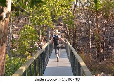 Australian adult woman hiking at Litchfield National Park in the  Northern Territory of Australia