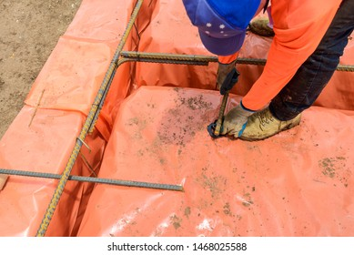 Australian builder performing steel fixing works of a new suburban house