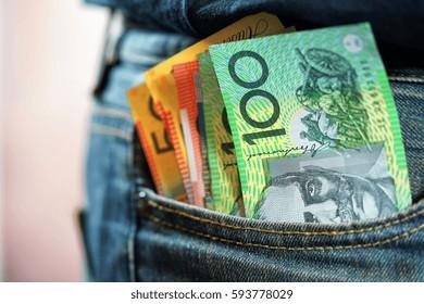 Australian cash money in mans jeans pocket, close up.