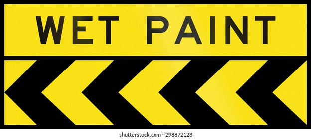 Australian chevron alignment pointing to the left with the words: Wet paint