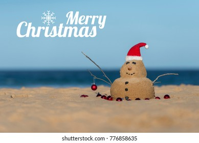 Australian Christmas Sandman with decoration and with a Merry Christmas text on the iconic Bondi Beach in Sydney