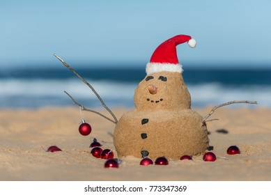 Australian Christmas Sandman with decoration on the iconic Bondi Beach in Sydney