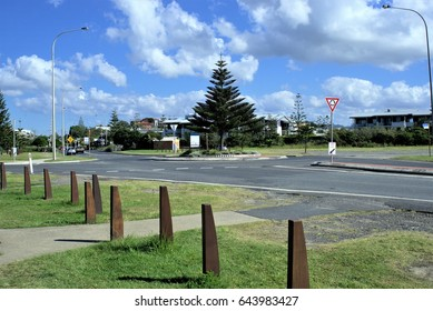 Australian City street view of roundabout in Coffs Harbour . Australian city road at traffic roundabout.