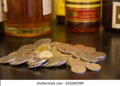 Australian coins on dirt bar at airport, tip for bar tender