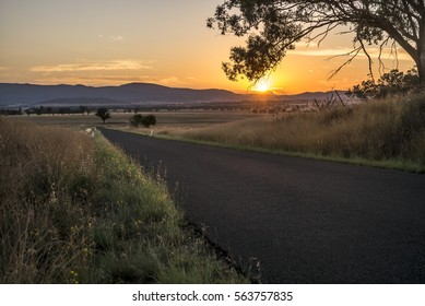 Australian country road with sunrise