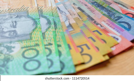 Australian currency closeup of fives, tens, twenties, fifties and one hundred notes, shallow DOF.