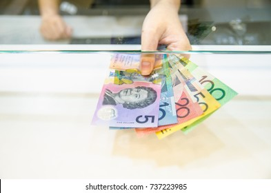 Australian dollar (AUD), Australia money, Women giving money currency of Australia. Exchange money for Australian dollar (AUD), business and finance concept.