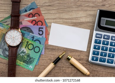 Australian dollar with business card, pen and calculator