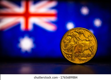 Australian dollar coin isolated on Australia flag background with space for copy text. One dollar coin 1995 Australian currency. Old coins collection world wide.