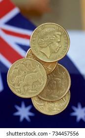 Australian dollar coins falling with the Australian flag.