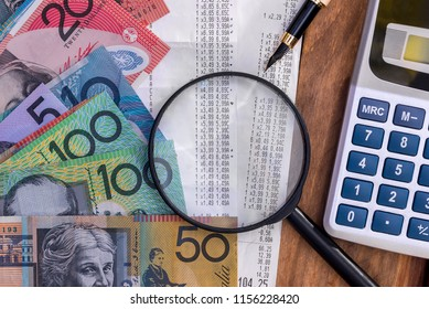 Australian dollars with receipt, calculator, pen and magnifier