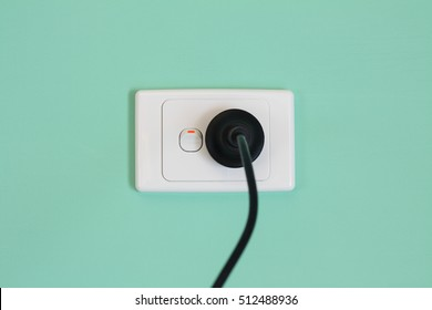 Australian electric power wall outlet and power cord.