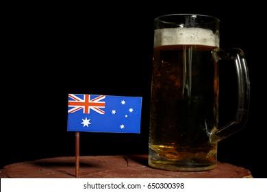 Australian flag with beer mug isolated on black background