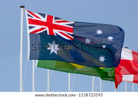 The Australian Flag Fluttering at the Front of a row of International Flags