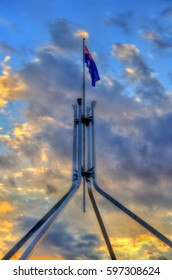The Australian flag flying on top of Parliament House in Canberra