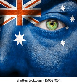 Australian flag painted on a man's face to support his country Australia