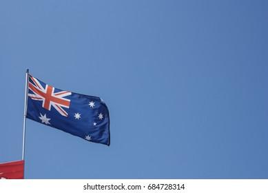 Australian Flag Waving against a Blue Sky