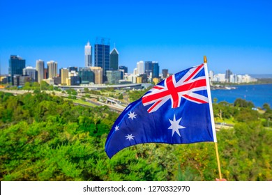 Australian flag waving aver Perth Water, a section of Swan River, and central business district of Perth from Kings park, the most popular visitor destination in WA. Blue sky. Perth skyline aerial