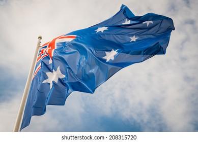Australian flag waving cloudy sky