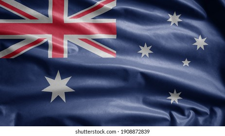Australian flag waving in the wind. Close up of Australia banner blowing, soft and smooth silk. Cloth fabric texture ensign background. Use it for national day and country occasions concept.
